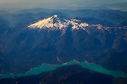 Mount Baker towers over the turquoise-colored Baker Lake in this aerial view over Whatcom County, Washington. Mount Baker, which is 10,781 feet (3,286 meters) tall, has the second-most thermally active crater of any volcano in the Cascade Range, behind only Mount St. Helens. Baker Lake gets its turquoise color from glacial silt, which gets trapped in its water.