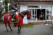 A horserider in a samurai armor during a challenge visit to provoke in the old samurai way the chairman of the Soma Nomaoi festival Ushitaga Yasumitu in Minami Soma
