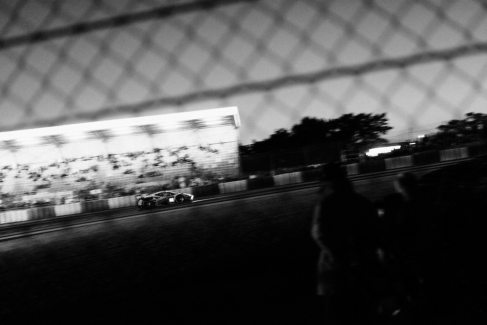 Dusk falls at the 2014 Le mans 24 hr race. Le Mans, France, 14th June 2014. Photo by Greg Funnell.