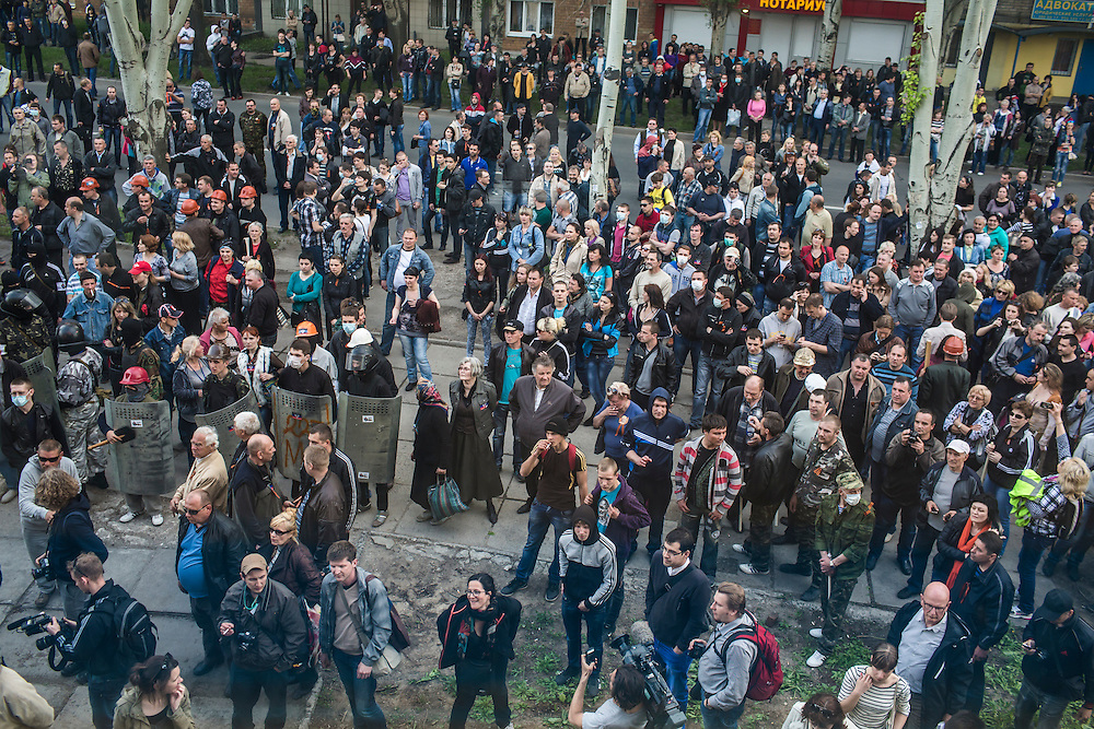 DONETSK, UKRAINE - MAY 4: A crowd watches from outside as pro-Russian protesters occupy and ransack the military prosecutor's office on May 4, 2014 in Donetsk, Ukraine. Cities across Eastern Ukraine have been overtaken by pro-Russian protesters in recent weeks, leading the Ukrainian military to respond with force in some areas. (Photo by Brendan Hoffman for The Washington Post)