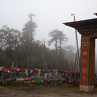 Asia, Bhutan, Trongsa. Prayer flags mark Yutong La Pass, between Trongsa and Bumthang.