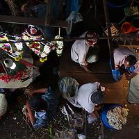 Flower dealers in Chennai's Koyambedu Fruit Market, Tamil Nadu, India