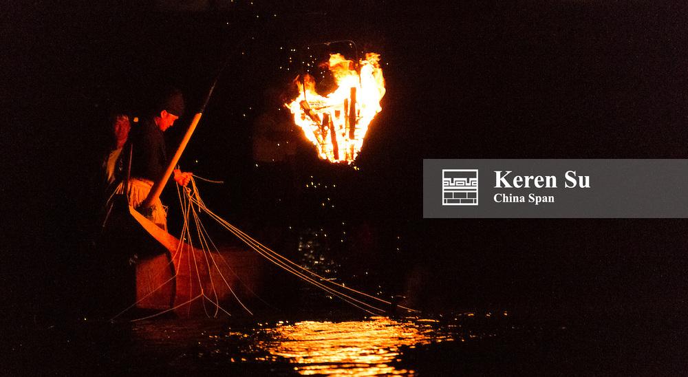 Fisherman fishing on Nagara River at night, Gifu, Gifu Prefecture, Japan