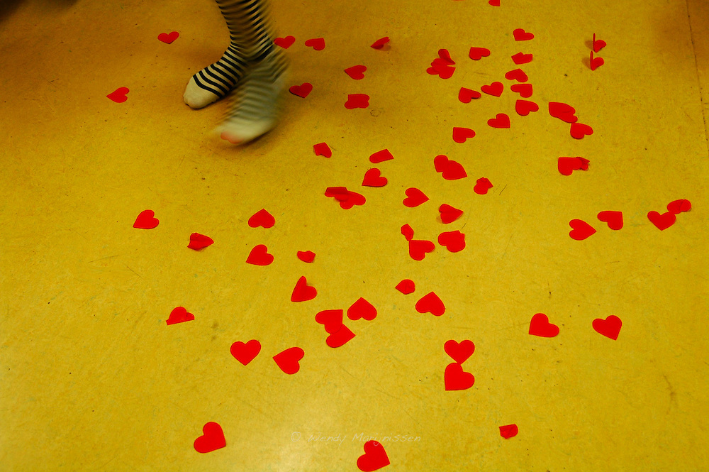 The dressing room floor is covered with paper hearts used during the performance of the Devilles Harem Girls. Ghent, Belgium, 2008