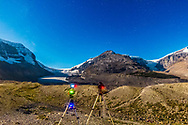 Timelapse cameras working at the Columbia Icefields, Jasper National Park, Alberta, Sept 6, 2014. The Athabasca Glacier is at left and the Snowdome Glacier is at right. Moonlight provides the illumination.<br /> <br /> This is a single shot with the Canon 60Da at ISO 3200 and 14mm Rokinon lens at f/2.8 for 6 seconds. The camera on the left is on the eMotimo motion controller doing a panning sequence; the camera on the right is on a static tripod doing a star trail sequence, for a composite still image and for a movie.