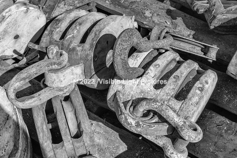 Old wooden block and tackle pulleys at the Wooden Boat Show at Mystic Seaport, Mystic CT