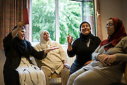 Senior women from Moroccan descent come together and participate in a quiz. Every two weeks discussing issues like breast cancer, energy use, healthy food, etc...They socialize and are able to talk openly about their lives and the problems they face. Antwerp, Belgium, 2012