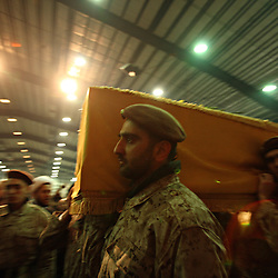Members of Hezbollah's elite military wing, the Islamic Resistance of Lebanon, carry the coffin of slain militant commander Imad Mugniyeh in Beirut, Lebanon on Feb. 14, 2008. Imad Mugniyeh was killed in a mysterious car bombing in Damascus, Syria. Mugniyeh a.k.a. Hajj Radwan, was among the most feared terror operatives in the world. The Islamic Resistance of Lebanon rarely appears in uniform publicly.