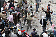 An Egyptian soldier tries to stop fighting between anti and pro- government protesters during clashes in downtown Cairo, Egypt, Thursday, Feb. 3, 2011. New clashes are heating up again and shots are being fired in the air around Cairo's central Tahrir Square as anti-government protesters push back regime supporters.The two sides are trading volleys of stone-throwing, but government backers are falling back and protesters are swarming onto a highway overpass from which their rivals had pelted them with stones and firebombs overnight.(Photo by Heidi Levine/Sipa Press).
