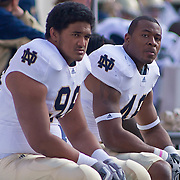 Norte Dame Junior Defensive Tackle (#98) Sean Cwynar and Sophomore Outside Linebacker (#46) Steve Filer on the sideline during game action at The New Giant's Stadium as Navy defeats Notre Dame 35-17 at The New Giant's Stadium in East Rutherford New Jersey