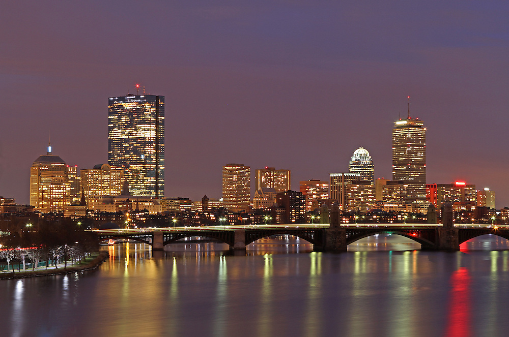 Boston skyline night photography showing landmarks such as John Hancock building, Prudential Center, and Longfellow Bridge captured on an overcast day in December at twilight.<br /> <br /> This Boston night photography picture of the famous skyline buildings is available as museum quality photography prints, canvas prints, acrylic prints or metal prints. Prints may be framed and matted to the individual liking and decorating needs:<br /> <br /> http://juergen-roth.artistwebsites.com/featured/boston-redline-juergen-roth.html?newartwork=true<br /> <br /> All photographs are available for digital and print use at www.ExploringTheLight.com. Please contact me direct with any questions or request.<br /> <br /> Good light and happy photo making! <br /> <br /> Juergen <br /> www.rothgalleries.com <br /> www.exploringthelight.com<br /> http://whereintheworldisjuergen.blogspot.com<br /> @NatureFineArt<br /> https://www.facebook.com/naturefineart