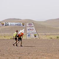 24 March 2007:  Runners walk next to the starting line the day before the beginning of the 22nd Marathon des Sables, a 6 days and 151 miles endurance race with food self sufficiency across the Sahara Desert in Morocco. Each participant must carry his, or her, own backpack containing food, sleeping gear and other material.