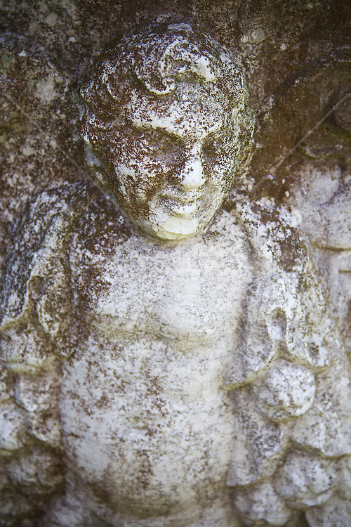 angel statue on an urn