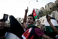 JORDAN, Amman : Jordanian protesters scream during a pro government demonstration in Amman on April 1, 2011, as they called for reforms, a week after clashes between them and government supporters killed a man and injured 160.ALESSIO ROMENZI