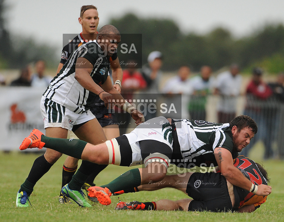 GEORGE, SOUTH AFRICA - Saturday 7 March 2015, Richard Aingworth of Vaseline Wanderers is heavily tackled by Armand Coetzee of Pacaltsdorp Evergreens during the third round match of the Cell C Community Cup between Pacaltsdorp Evergreens and Vaseline Wanderers at Pacaltsdorp Sports Grounds, George<br /> Photo by Roger Sedres/ImageSA/ SARU