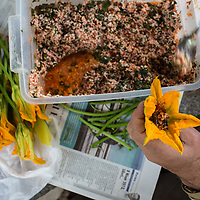 Stuffing squash blossoms with mint-seasoned rice at Kaplan Dag Restoran