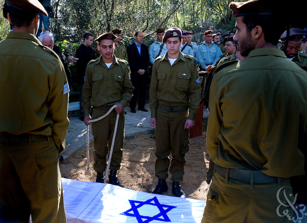 Israeli soldiers lower the casket of Staff Sgt. Nitai Stern, 21, who died in an operation in the Gaza Strip Monday, during his funeral at the Mt. Herzl cemetery in Jerusalem, Tuesday, Jan. 6, 2009. Stern and two other soldiers were killed when an Israeli tank shell mistakenly fired on their position in an apparent friendly-fire incident, Israeli sources said.