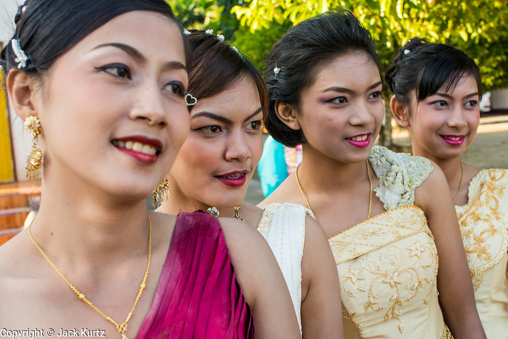 31 OCTOBER 2012 - YARANG, PATTANI, THAILAND:  Women from the community gather in Wat Kohwai for an Ok Phansa procession to Yala. Ok Phansa marks the end of the Buddhist 'Lent' and falls on the full moon of the eleventh lunar month (October). It's a day of joyful celebration and merit-making. For the members of Wat Kohwai, in Yarang District of Pattani, it was a even more special because it was the first time in eight years they've been able to celebrate Ok Phansa. The Buddhist community is surrounded by Muslim villages and it's been too dangerous to hold the boisterous celebration because of the Muslim insurgency that is very active in this area. This the year the Thai army sent a special group of soldiers to secure the village and accompany the villagers on their procession to Yala, a city  about 20 miles away.  PHOTO BY JACK KURTZ