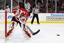 Oct 17, 2009; Newark, NJ, USA; New Jersey Devils goalie Martin Brodeur (30) plays the puck during the first period of their game against the Carolina Hurricanes at the Prudential Center.