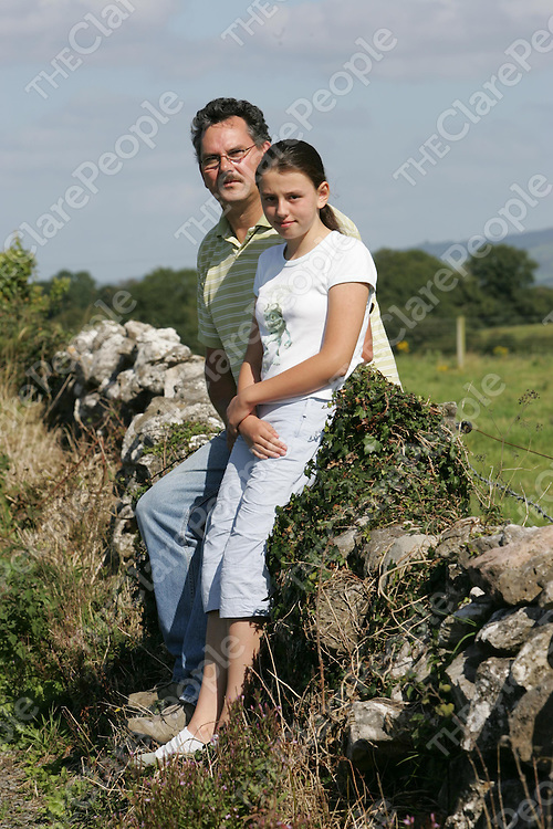 Vincent O'Neill, pictured with his daughter Rebecca(12) near their home in Kilmurry, Co. Clare.  Rebecca is unable to get the bus to her school in Ennis 17 miles away as she is deemed to be outside the catchment area.<br />