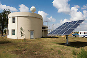 "Greensburg, Kansas, USA..Solar panel at The Greensburg Silo Home. ..With precast concrete walls and a cylindrical form, this house will stand up to very strong winds. It also has a LEED rating of level 47. The Greensburg Silo Home is a part of The Chain of Eco-Homes--a series of twelve green houses that will serve as ""living laboratories"" featuring all types of building techniques, energy efficiency features, and green living products. Each will be available both as an informational center and as eco-lodging where people can experience green living first-hand...Greensburg GreenTown is a grassroots community-based organization which has worked side-by-side with city and county officials, business owners and local residents to incorporate sustainable principles into their rebuilding process. GreenTown serves as an educational resource for the community, a conduit through which donations can be distributed, and a representative to those outside the community who are interested in the Green Initiative...""Greensburg: Better, Stronger, Greener!"".On May 4, 2007, an EF5 tornado cut a 1.7-mile path of destruction through Greensburg, Kansas. Winds reaching speeds of 205 miles per hour uprooted trees, demolished homes and leveled the town. Eleven people died and 95% of the buildings were destroyed beyond repair. Residents have since worked furiously to rebuild it in a way that is both economically and environmentally sustainable and to meet the highest environmental standards. Greensburg, whose population has dropped from about 1400 to 800 following the storm and is now growing again, is currently the greenest town in America and the first in the United States to pass a resolution to certify that all city-owned buildings earn LEED Platinum accreditation, the highest level of the LEED rating system...Photo © Stefan Falke"