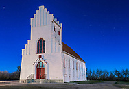 The constellation of Cassiopeia (the W at right) behind the old Bethlehem Lutheran Church in Dalum, south of Drumheller, Alberta. It was built in 1929 by the Danish settlers in the area, using traditional Danish architechtural styles. <br /> <br /> I shot this May 2, 2015 on the night before Full Moon which provides most of the illiumination. Streetlights added yellow tints but I minimized those in processing. This is a single 30-second exposure at ISO 400 with the Canon 6D and f/5.6 with the 35mm lens.