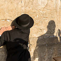 Israel, Jerusalem, Rear view of Orthodox Jewish men praying at Western Wall