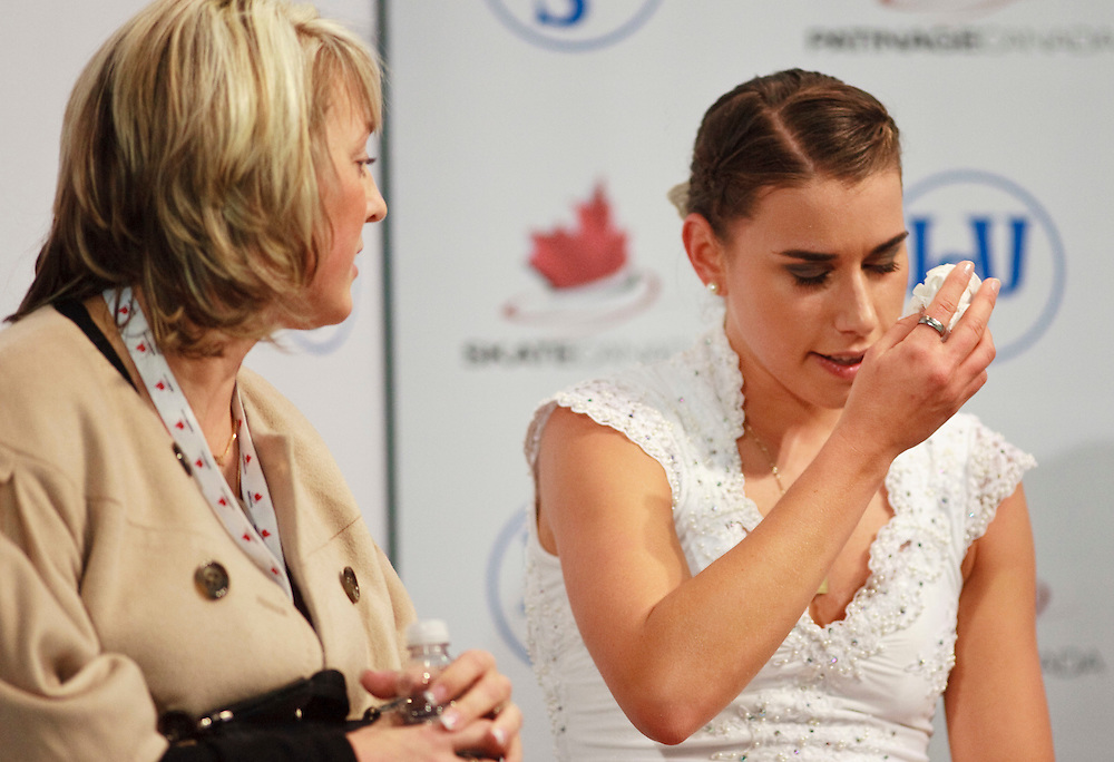 20101030 -- Kingston, Ontario -- Cynthia Phaneuf of Canada reacts to the marks for her free skate at Skate Canada International in Kingston, Ontario, Canada, October 30, 2010. Phaneuf led after the short program but fell to 4th after several errors in her long program<br /> AFP PHOTO/Geoff Robins