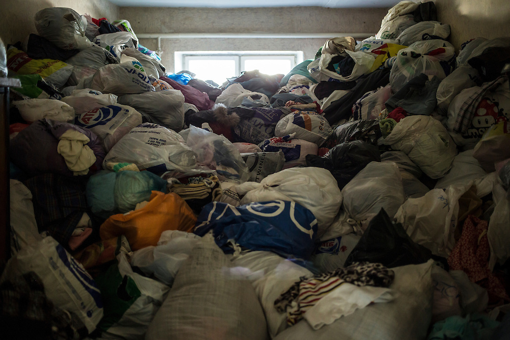 DNIPROPETROVSK, UKRAINE - OCTOBER 10: Hundreds of bags of donated clothes available for people who fled with few belongings fill one of several rooms at The Aid of Dnipro, a charity organization providing assistance to displaced people from Eastern Ukraine, on October 10, 2014 in Dnipropetrovsk, Ukraine. While the charity has received many donations of clothes and toys, they are having a difficult time providing enough food to those in need. The United Nations has registered more than 360,000 people who have been forced to leave their homes due to fighting in the East, though the true number is believed to be much higher. (Photo by Brendan Hoffman/Getty Images) *** Local Caption ***