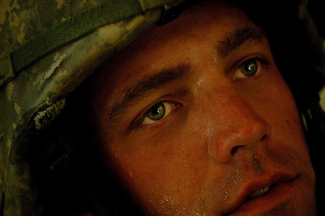 PFC Albert Fogle from Bravo Company 1/17th Infantry 172nd Stryker BDE Ft. Wainwright, Alaska, sits in his Stryker (an eight wheeled medium armored weapons combat troop transport vehicle) after finishing a mission June 18, 2006 in Mosul, Iraq. — © TSgt Jeremy Lock/