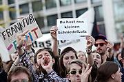 Frankfurt am Main   21 Apr 2015<br /> <br /> Am Dienstag (21.04.2015) hielt die rassistische und islamfeindliche Gruppe PEGIDA (Patriotische Europ&auml;er gegen die Islamisierung des Abendlandes) an der Hauotwache neben der Katharinenkirche in Frankfurt am Main eine Mahnwache unter dem Motto &quot;Wir sind wieder da&quot; ab. Die Kundgebung war wie immer mit Hamburger Gittern abgesperrt und von starken Polizeikr&auml;ften bewacht. Etwa 1000 Menschen nahmen an den Gegenprotesten teil.<br /> Hier: Bei den Gegenprotesten h&auml;lt eine Demonstrantin ein kleines Plakat mit der Aufschrift &quot;Du hast nen kleinen SchniedelLutz&quot; hoch, sie bezieht sich mutmasslich auf den m&ouml;glicherweise sehr kleinen Penis des heute nicht anwesenden PEGIDA-Aktivisten Lutz Bachmann aus Dresden.<br /> <br /> &copy;peter-juelich.com<br /> <br /> [Foto Honorarpflichtig   No Model Release   No Property Release]