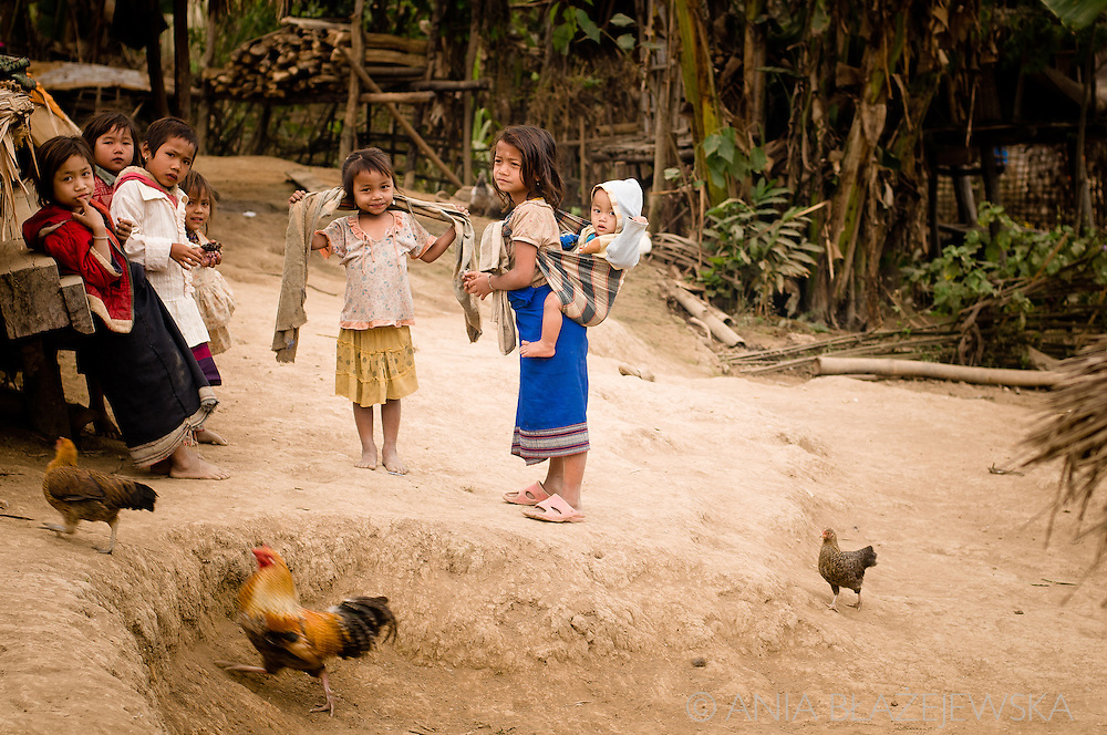 Laos, village in the Luang Nam Tha area. Khamu children in a village.