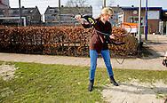 King Willem-Alexander and Queen Maxima of The Netherlands volunteering at playground and community Vreugdeoord in Alpen aan den Rijn, The Netherlands, 12 March 2016. NL Doet is in initiative of the Oranje Fonds, the King and Queen are patron and patroness of the foundation. Photo: robin utrecht <br /> Koning Willem-Alexander en Koningin Maxima nemen deel aan vrijwilligersactie NL Doet en klussen mee in speeltuin en buurtvereniging Vreugdeoord in Alpen aan den Rijn, 12 Maart 2015. NL Doet is een vrijwilligersactie van het Oranje Fonds, de koning en de koningin zijn beschermheer en beschermvrouwe van het fonds. Foto: robin utrecht  <br /> Koning Willem-Alexander en Hare Majesteit Koningin M&aacute;xima en leden van de Koninklijke Familie hebben op vrijdag 11 maart en zaterdag 12 maart deelgenomen aan NLdoet van het Oranje Fonds, de grootste vrijwilligersactie van Nederland.<br />  Koning Willem-Alexander en Koningin M&aacute;xima zijn zaterdag aan de slag gegaan bij speeltuin- en buurtvereniging Vreugdeoord in Alphen aan den Rijn. Deze buurt- en speeltuinvereniging bestaat al sinds 1951 en is d&eacute; ontmoetingsplek voor de buurt. De Koning en Koningin hebben meegewerkt aan het kruien van nieuw zand naar de zandbak en het reinigen van de speeltoestellen. Prinses Beatrix, Prins Constantijn, Prins Floris en Prinses Aim&eacute;e hebben zich op vrijdagochtend ingezet bij de Prinses M&aacute;xima Manege in Den Dolder, een hippisch therapeutisch centrum voor mensen met en zonder een beperking. Wekelijks komen zo&acute;n 200 kinderen en volwassenen met een lichamelijke, zintuiglijke of psychische beperking naar de manege om met behulp van paarden hun welzijn te bevorderen.<br /> De Koninklijke Familie ging aan de slag met timmer- en schilderwerk, het begaanbaar maken van bospaden voor ruiters en hun begeleiders en het rijden met een huifbed voor mensen met een meervoudige beperking.<br /> Prinses Margriet en prof.mr. Pieter van Vollenhoven hielpen vrijdagmiddag mee in het 