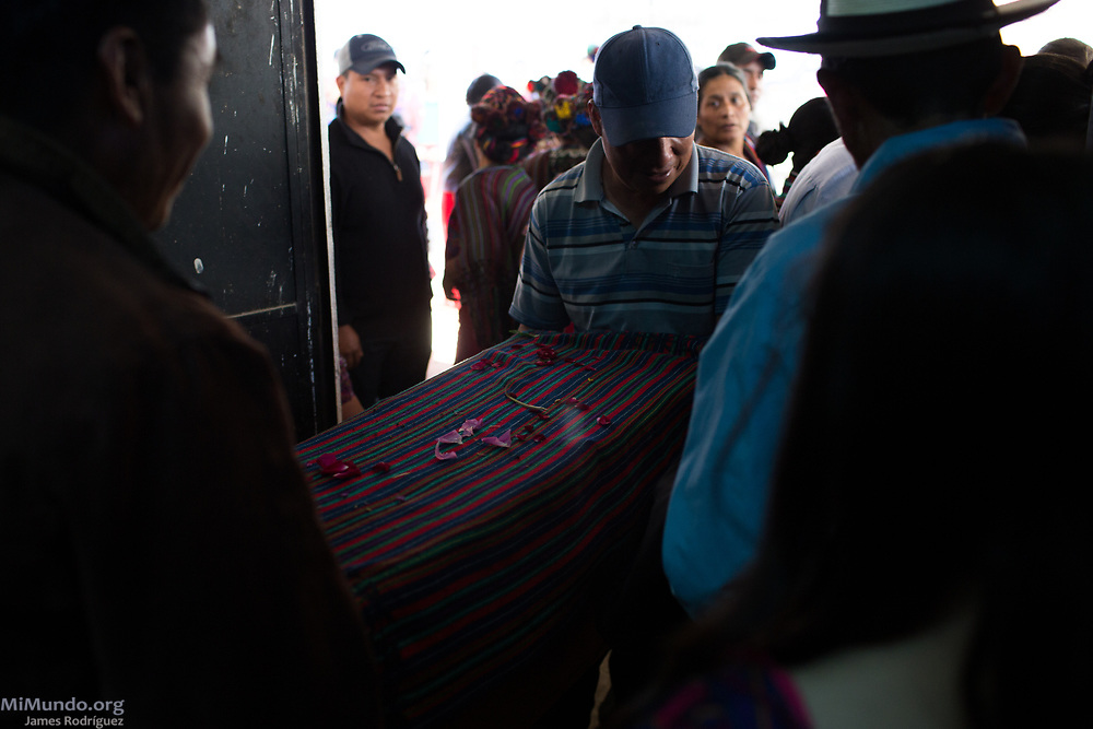 Friends and family head to the Acul cemetery to bury the human remains of 36 Ixil Mayan war victims. Most of the victims, exhumed from mass graves in Xe'xuxcap, near Acul, starved in the mountainside while fleeing State-led repression in 1982. Most of the remains, exhumed by members of the Forensic Anthropology Foundation of Guatemala (FAFG) in 2013, were identified using DNA analysis and properly buried 35 years after their death. Acul, Nebaj, Quiché, Guatemala. February 3, 2017.