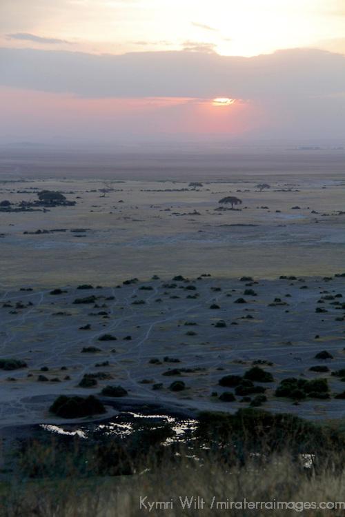 Africa, Kenya, Amboseli. Sunset over landscape of Amboseli.
