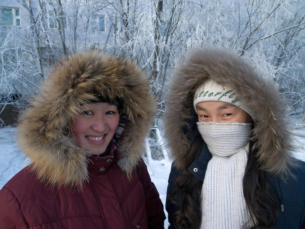 Zwei jakutische Frauen mit Kopfbedeckung gesch&uuml;tzt gegen die extreme Kaelte in der Innenstadt von Jakutsk. Jakutsk wurde 1632 gegruendet und feierte 2007 sein 375 jaehriges Bestehen. Jakutsk ist im Winter eine der kaeltesten Grossstaedte weltweit mit durchschnittlichen Winter Temperaturen von -40.9 Grad Celsius. Die Stadt ist nicht weit entfernt von Oimjakon, dem Kaeltepol der bewohnten Gebiete der Erde.<br /> <br /> Two Yakut women protected with headgears against the extrem climate  in the city center of Yakutsk. Yakutsk was founded in 1632 and celebrated 2007 the 375th anniversary. Yakutsk is a city in the Russian Far East, located about 4 degrees (450 km) below the Arctic Circle. It is the capital of the Sakha (Yakutia) Republic (formerly the Yakut Autonomous Soviet Socialist Republic), Russia and a major port on the Lena River. Yakutsk is one of the coldest cities on earth, with winter temperatures averaging -40.9 degrees Celsius.