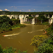 South America, Brazil, Argentina, Igwazu Falls, Igwacu Falls. The Mosquertos (Musketeers) tumble from the cliff tops in to the Igwazu River.