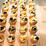 Fruit cups in waffle cones.  Dessert buffet.