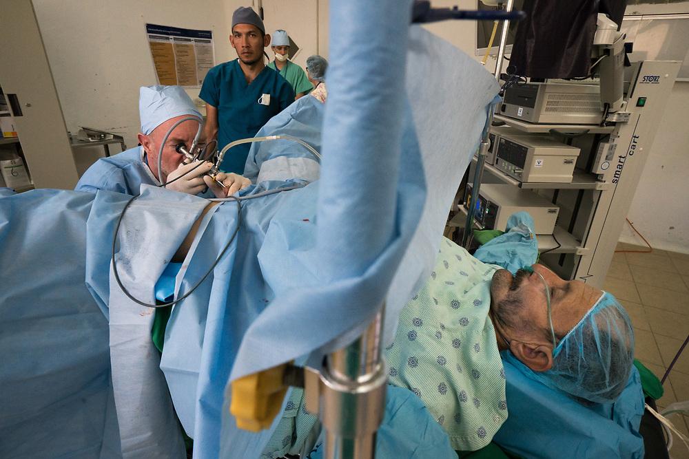 Urologist Dr. Paul Crowley, a volunteer with Central American Medical Outreach operates on a patient at Occidente Hospital in Santa Rosa de Copan, Copan, Honduras March 2, 2017. Photo Ken Cedeno