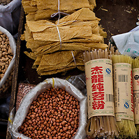 Ingredient including dried beancurd skin and peanuts for sale from a street vendor