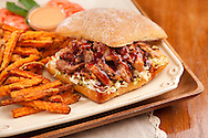 Pork bbq sandwich with a side of homestyle fries
