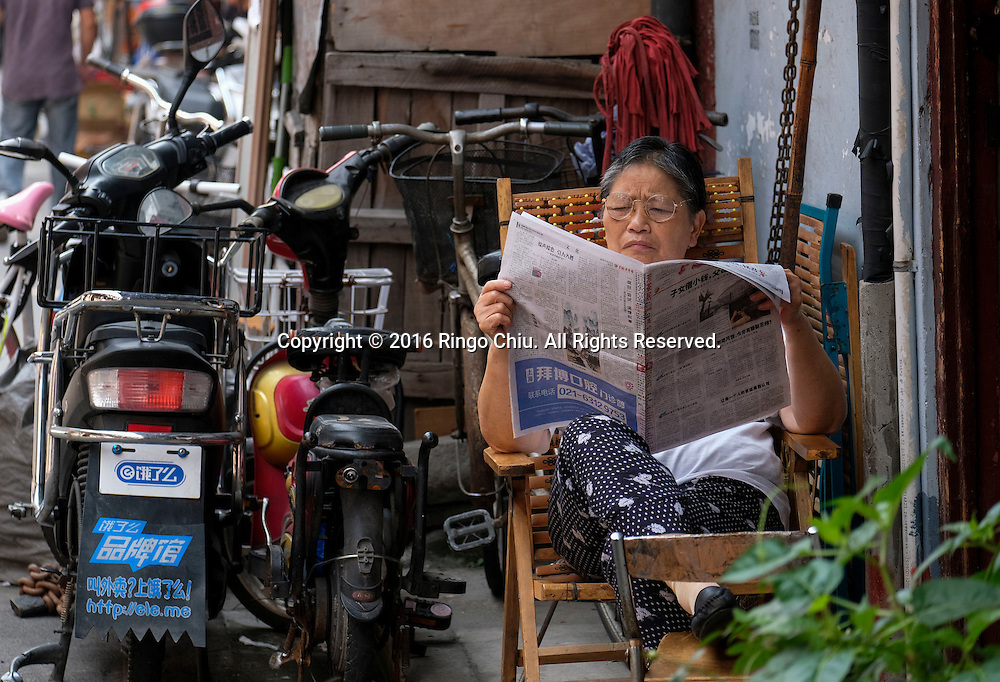 "A woman reads newspaper at the old residential district near Yu Garden in Shanghai, China. Shanghai is the most populous city in China and the most populous city proper in the world. It is one of the four direct-controlled municipalities of China, with a population of more than 24 million as of 2014. It is a global financial centre, and a transport hub with the world's busiest container port. Located in the Yangtze River Delta in East China, Shanghai sits on the south edge of the mouth of the Yangtze in the middle portion of the Chinese coast. The municipality borders the provinces of Jiangsu and Zhejiang to the north, south and west, and is bounded to the east by the East China Sea. A major administrative, shipping, and trading town, Shanghai grew in importance in the 19th century due to trade and recognition of its favourable port location and economic potential. The city was one of five forced open to foreign trade following the British victory over China in the First Opium War while the subsequent 1842 Treaty of Nanking and 1844 Treaty of Whampoa allowed the establishment of the Shanghai International Settlement and the French Concession. The city then flourished as a center of commerce between China and other parts of the world (predominantly Western countries), and became the primary financial hub of the Asia-Pacific region in the 1930s. However, with the Communist Party takeover of the mainland in 1949, trade was limited to socialist countries, and the city's global influence declined. In the 1990s, the economic reforms introduced by Deng Xiaoping resulted in an intense re-development of the city, aiding the return of finance and foreign investment to the city. Shanghai has been described as the ""showpiece"" of the booming economy of mainland China; renowned for its Lujiazui skyline, museums and historic buildings, such as those along The Bund, the City God Temple and the Yu Garden."