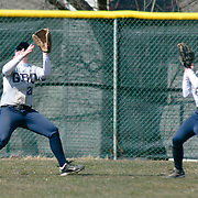 Goldey-Beacom Outfielders Michelle Foster (21) (left) make catches in left field in the fourth inning of a NCAA Central Atlantic Collegiate Conference game against Post University Saturday, March 30, 2013, at Nancy Churchmann Sawin Athletic Field in Wilmington Delaware.
