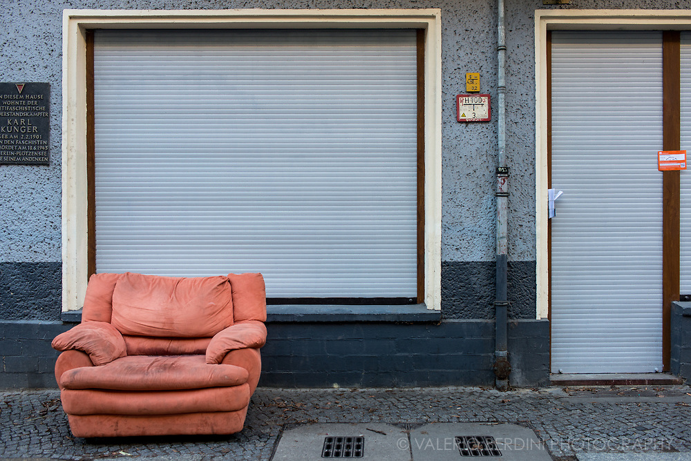 An abandoned sofa left in a street in East Berlin where Karl Kunger, a communist member of the anti nazi resistance, lived.
