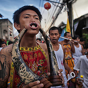Devotees to the Chinese shrine of Kathu gather at the annual Vegetarian Festival in Phuket, Thailand, Friday, Oct. 12, 2013. The a traditional Chinese vegetarian festival  emphasizes merit making and ritual cleansing of the body to mark the nine-day-long festival.  It also features face-piercing, spirit mediums, and strict vegetarianism.