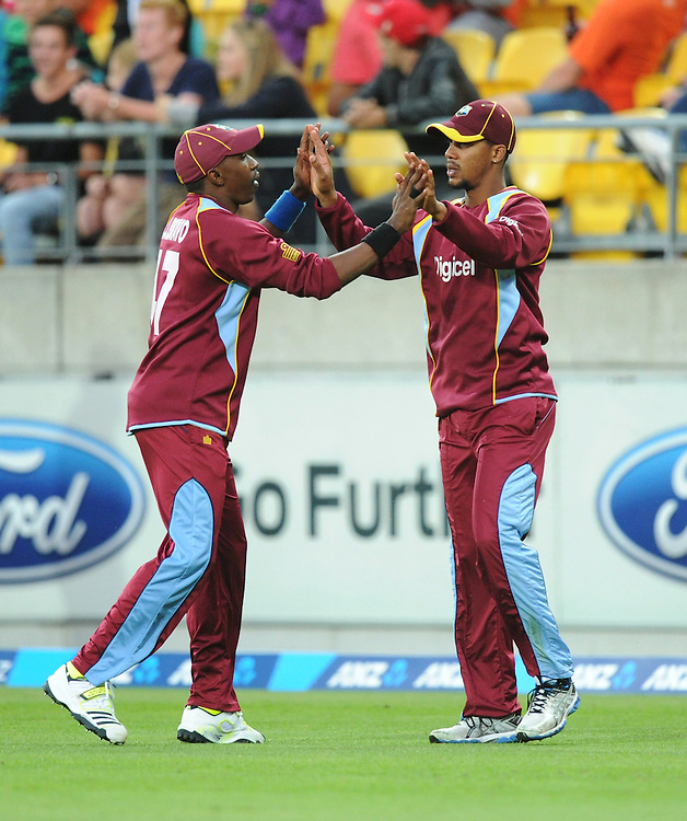 West Indies Lendl Simons, right, celebrates with his captain Dwayne Bravo after taking the catch on the boundary to dismiss New Zealand's Jessie Ryder for 21 in the second T20 International cricket match, Westpac Stadium, Wellington, New Zealand, Wednesday, January 15, 2014. Credit:SNPA / Ross Setford