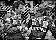 During qualifying in unseasonably cold conditions and shortened sessions for the 1982 Detroit Grand Prix, two-time World Champion Niki Lauda and John Watson  could not create enough heat in their Michelin tires to get the right balance for their Marlboro-McLaren's to find speed, and qualified 10th and 17th respectively. <br /> <br /> The morning of the race, the June heat returned and here, I caught a very relaxed Lauda and Watson seemingly unconcerned about their starting positions. <br /> <br /> In fact, it was if they knew a secret. They did. <br /> <br /> Michelin had told them that if they used a different tire choice, they might have a chance to win. Both made the change. <br /> <br /> Watson made an epoch charge from 17th to win the Grand Prix, while Lauda moved forward with Watson, until hitting the barriers trying to pass Keke Rosberg' Williams.