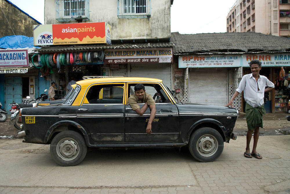 A taxi driver waiting for customers on 90ft road, one the main roads crossing dharavi slum. Mumbai, August 2007