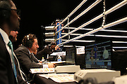 April 1, 2015 - New York, NY. Announcers, commentators and photographers watch the action in the ring. 04/01/2015 Photograph by Maya Dangerfield/NYCity Photo Wire