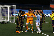 5/22/15- NYCFC midfielder Ned Grabavoy is restrained by the Union Goalkeeper after a foul during a NYCFC home match played at Yankee Stadium in the south Bronx.